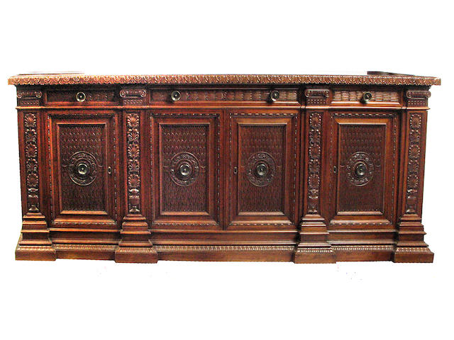 A Renaissance Revival carved mixed wood buffet