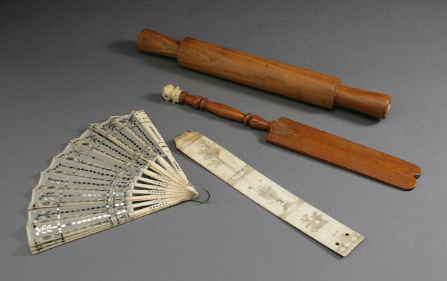 An engraved scrimshaw whalebone busk and an ivory fan