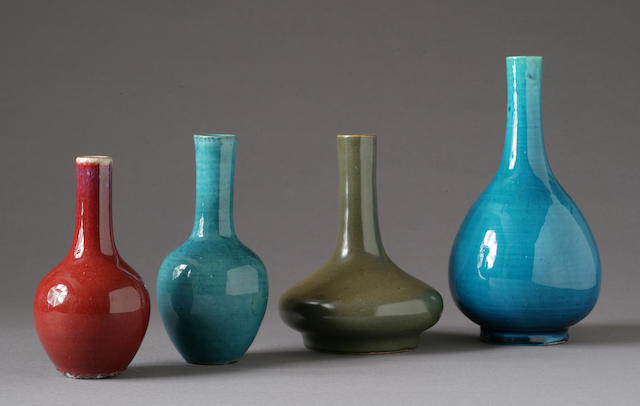 Four monochrome glazed stick neck vases 19th-Early 20th Century