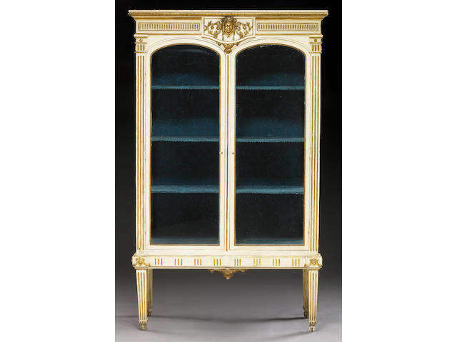An Italian Neoclassical style parcel gilt paint decorated display cabinet