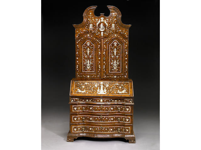A magnificent Italian Baroque shell and ivory inlaid walnut secretary bookcase