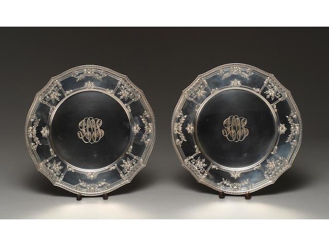 A set of twelve Gorham silver service plates