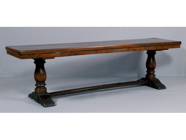 A Continental Baroque walnut refectory table