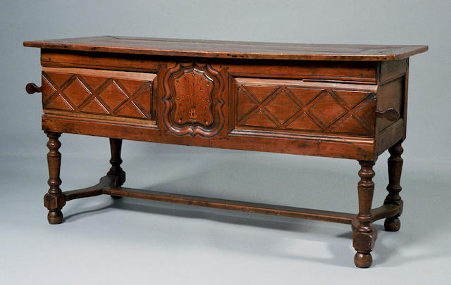 A Louis XIV provincial inlaid walnut table