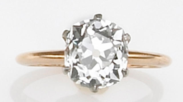 A diamond and fourteen karat bicolor gold solitaire ring