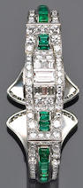 An art deco diamond, emerald and platinum bangle bracelet,
