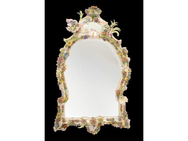 An imposing Continental porcelain mirror