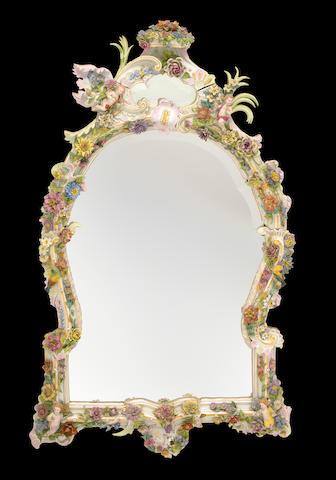 An imposing Continental porcelain mirror