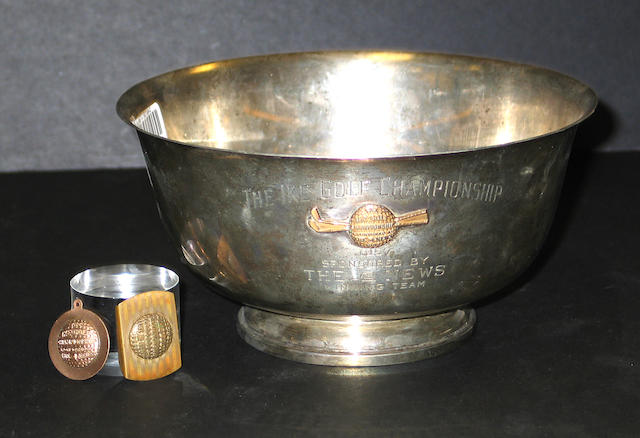 A large silver trophy in the shape of a bowl, dated 1957,