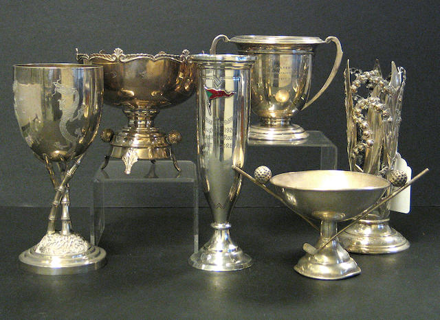 A selection of sterling and silver plated golfing trophies,