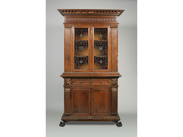 An Italian Baroque walnut cabinet