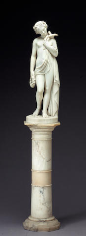 An Italian carved marble figure of Flora on pedestal