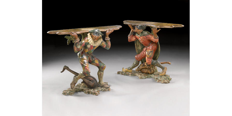 A pair of Venetian polychrome decorated carved pine console tables