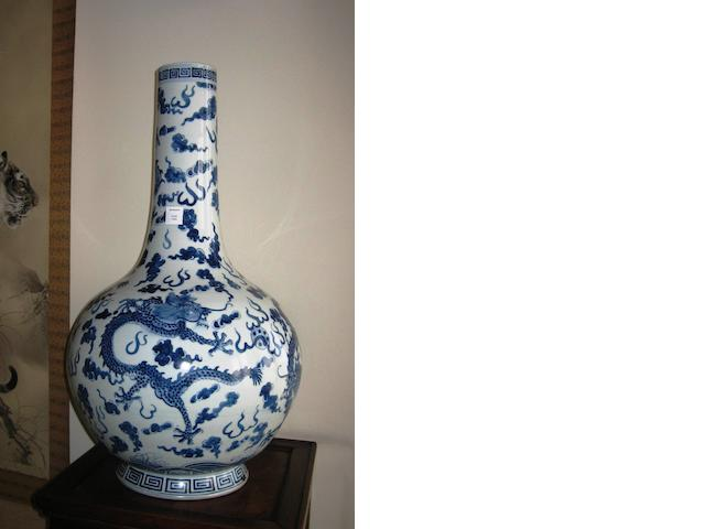 A large Chinese blue and white porcelain stick neck vase