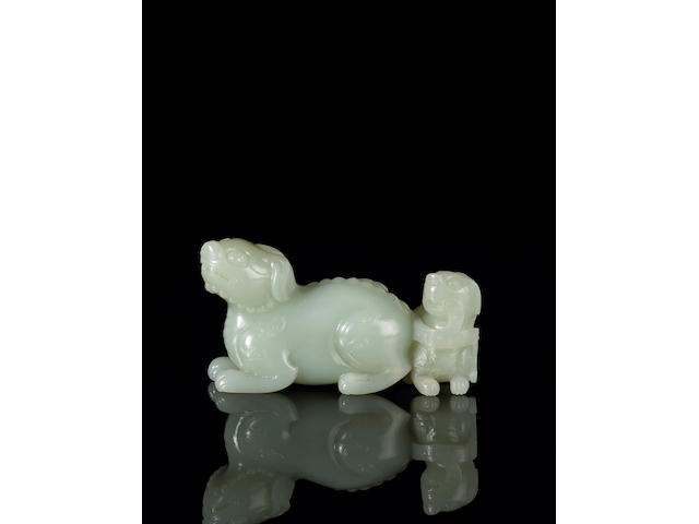 A pale greenish-white jade mythical beasts group 18th Century