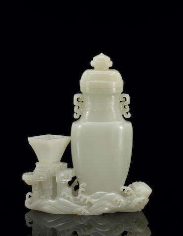 A finely carved pale celadon jade vase group  18th Century