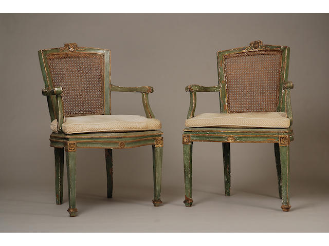 A set of five Italian Neoclassical green-painted arm-chairs and two later matching arm chairs