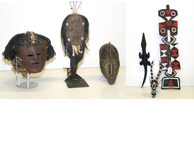 Six African items: carvings (2), masks (4)