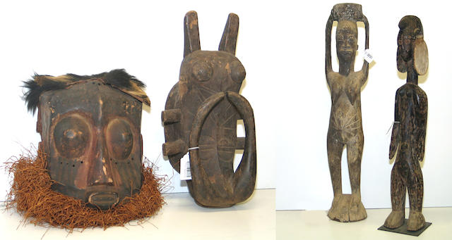 Four African items: carvings (2), masks (2)