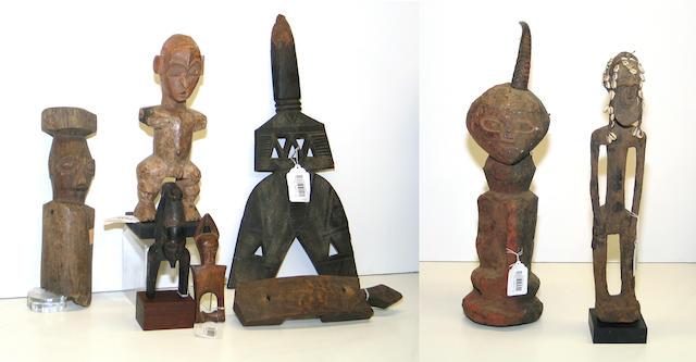 Eight African items: heddle pulleys (2), staff finial, door lock, figures (4)
