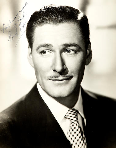 An Errol Flynn black and white signed photograph, 1940s