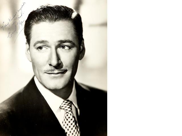 An Errol Flynn signed photograph
