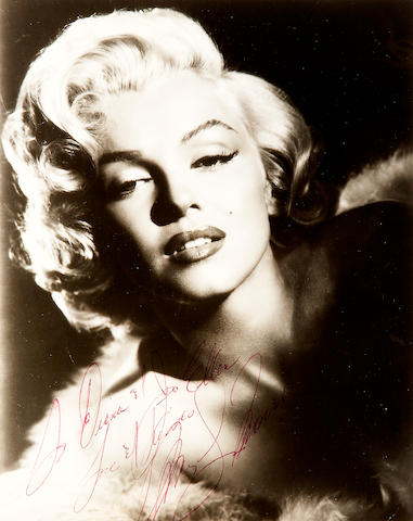 A Marilyn Monroe signed black and white photograph, circa 1955