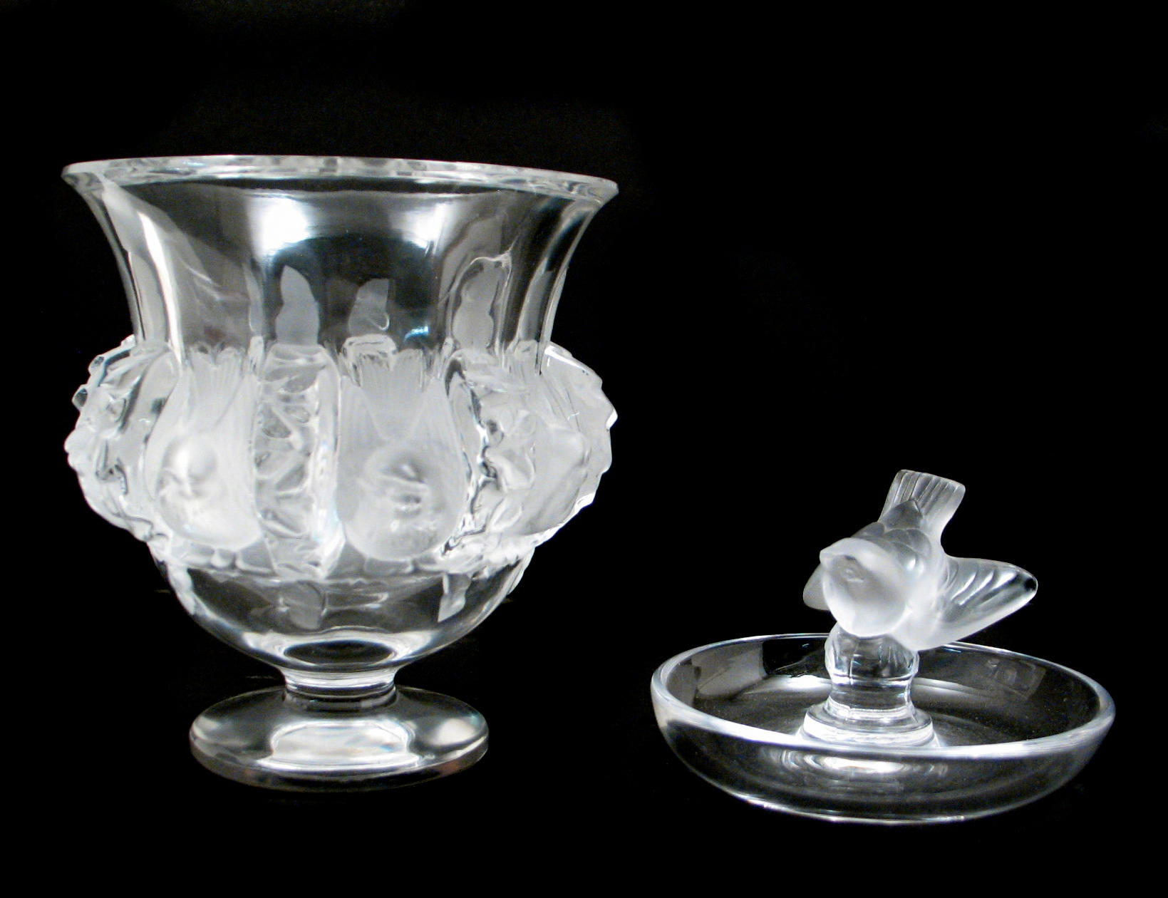 A group of four Lalique clear and frosted glass table articles
