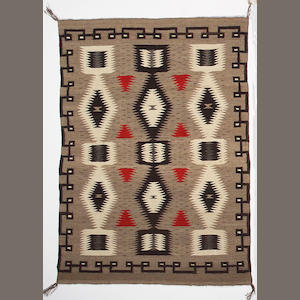 A Navajo rug, 4ft 8in x 3ft 3in