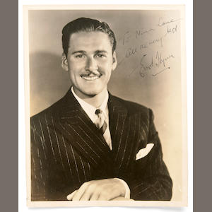 An Errol Flynn signed black and white photograph, 1940s