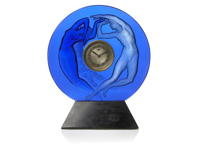 A René Lalique molded blue glass clock: Le Jour et la Nuit