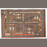 A Navajo sandpainting rug, 9ft 3in x 5ft 9in