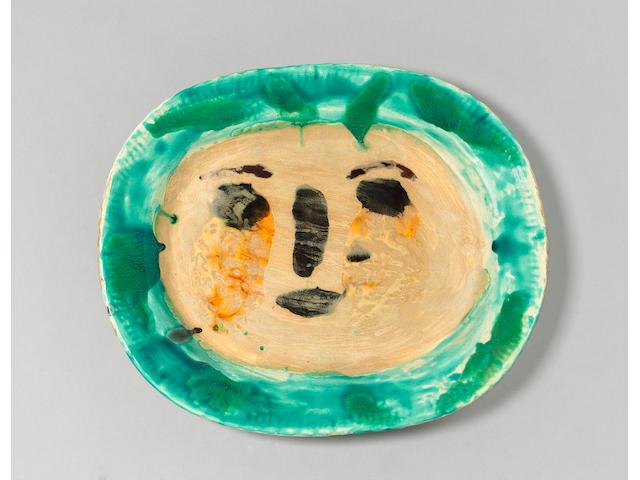 Pablo Picasso (Spanish, 1881-1973) 'Visage de Femme', a unique Dish, 1949 Width 38cm (15in.)