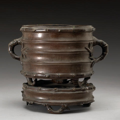 A Chinese cast bronze bamboo form tripod censer and stand Guangxu Period, dated 1883
