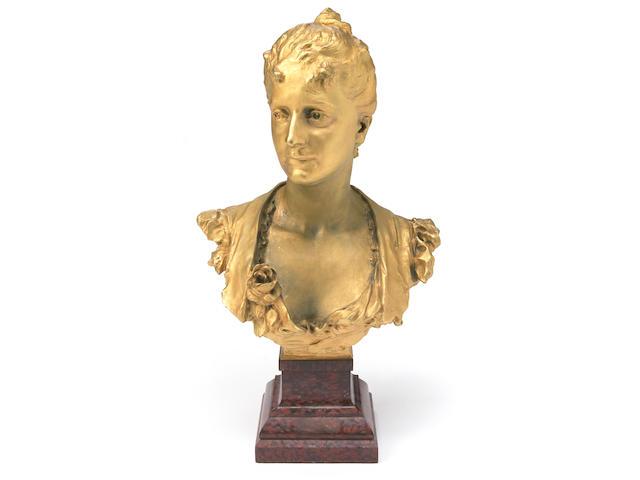 An Art Nouveau style gilt-bronze bust of a maiden