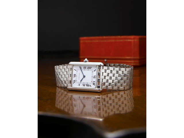 Cartier, Paris. A fine and unique platinum wristwatch on platinum bracelet Tank, No.A104482, circa 1