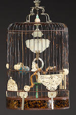 An impressive tortoise shell, ivory and jade birdcage with lacquered wood and cloisonné stand 19th C