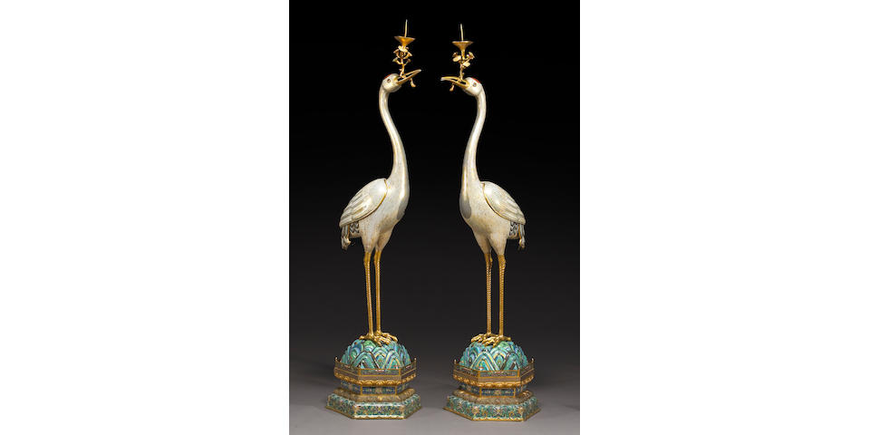 A pair of massive pieced cloisonné enameled metal standing crane form candle prickets