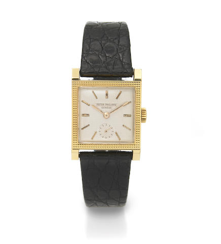 Patek Philippe. A fine 18k gold square wristwatch with hobnail finish case  Ref.2496, Case No.512789, Movement No.958257, circa 1952