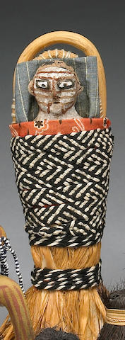 A Mojave doll and cradle
