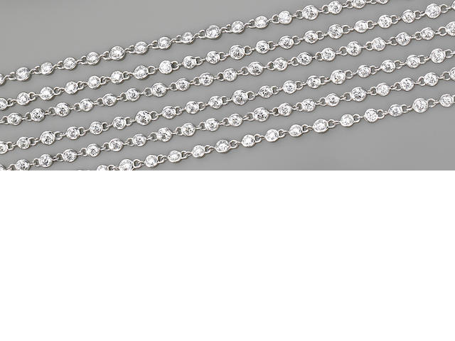 A diamond and eighteen karat white gold longchain