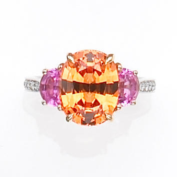 A spessartite garnet, pink sapphire, diamond, platinum and eighteen karat gold ring