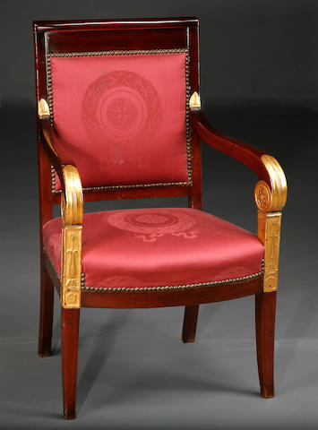 An Empire parcel gilt mahogany fauteuil