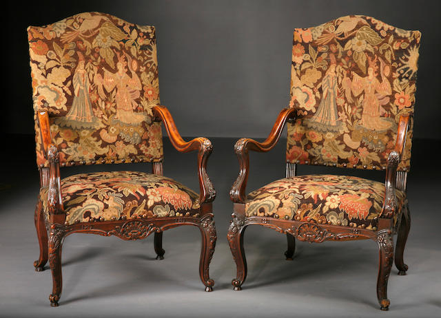 A pair of Régence style walnut and needlework upholstered armchairs