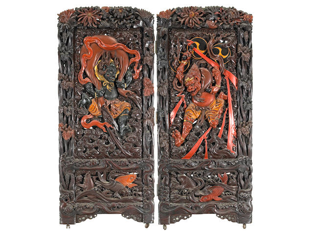 A large and impressive lacquered and carved wood two-panel folding screen Meiji Period