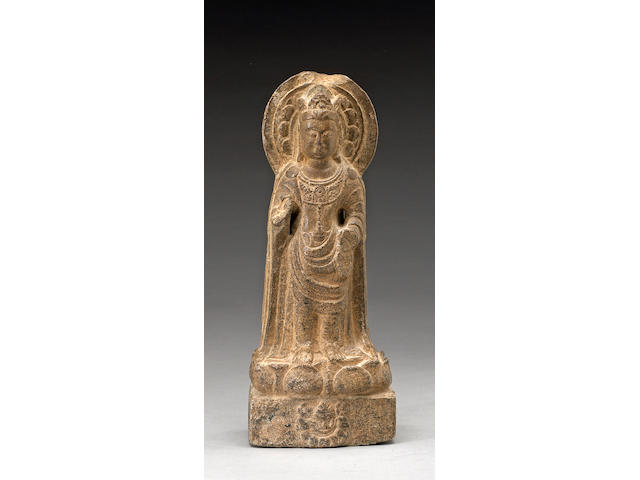 A fine carved limestone figure of Guanyin Northern Zhou Dynasty, dated 571