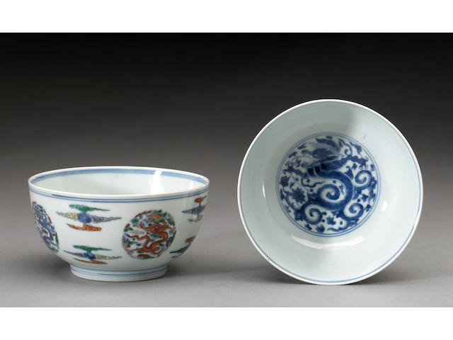A pair of doucai decorated porcelain deep bowls Kangxi Marks and Period