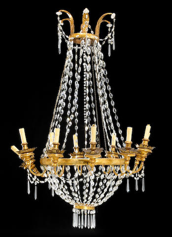 An Italian Neoclassical giltwood twelve light chandelier