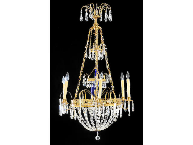 A Baltic Neoclassical gilt bronze cobalt blue and clear glass six light chandelier