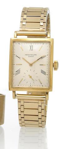 Patek Philippe. An 18k gold rectangular wristwatch with associated 14k gold braceletRef.1564, Movement No.838872, Case No.645526, circa 1947